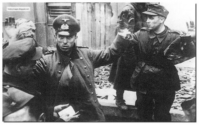 A-russian-soldier-checks-document-of-captured-germansoldiers-berlin-1945.jpg