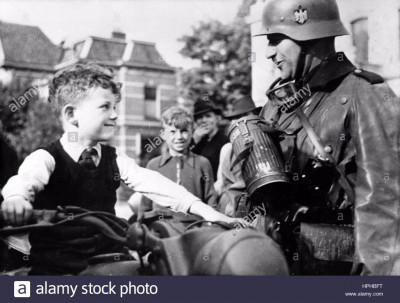 the-nazi-propaganda-image-shows-a-local-boy-on-a-motorcycle-next-to-HPHBFT.jpg